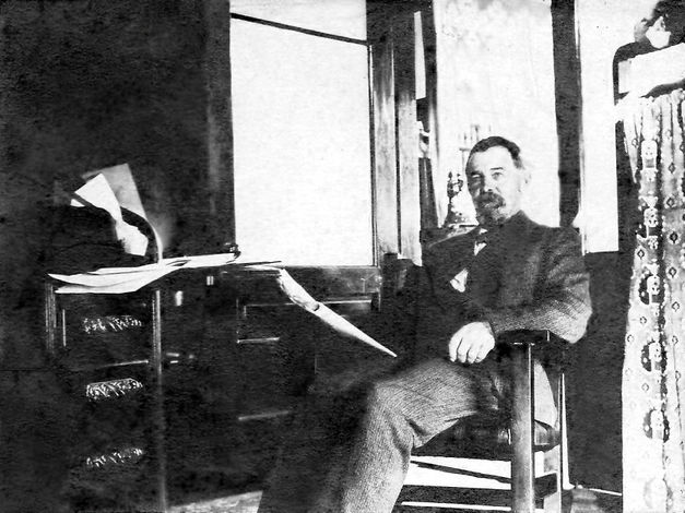 George Banks in his study.