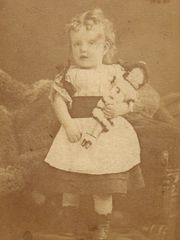 Mary around her first birthday, with black armband signifying mourning for her grandfather.
