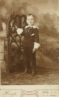 "About 6 years old, in his ""Little Lord Fauntleroy"" suit. Taken in Albia, Iowa."