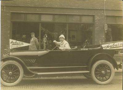 Driving her Auburn in a parade in Oskaloosa, 1915