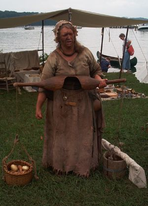 "Woman in 18th Dress, perhaps typical of what a pioneer woman might wear in Southwest Virginia, holding a ""shoulder-yoke"""