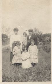 Arthur & Sylvia Shaefer holding Everett, Mildred & Mabel Shaefer and youngest daughter