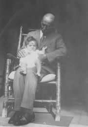 Frank with baby granddaughter, 1930