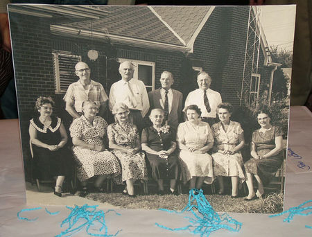 Courrege Siblings:  Front Row (L-R) Marie, Odille, Rose, Magitte, Leontine, Bertha, Lucy. Back Row (L-R) Emile, Albert, Joe, Lucien (Lut). Magitte's 75th Birthday