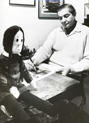 Charles Addams in his studio with life-size doll, Wednesday