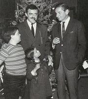 Charles Addams with three actors in the cast of The Addams Family television series.