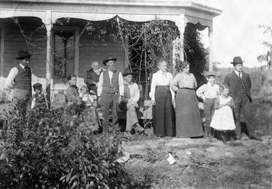 The Banks family in front of their home in Fawn Creek Township, west of Coffeyville, Kansas.